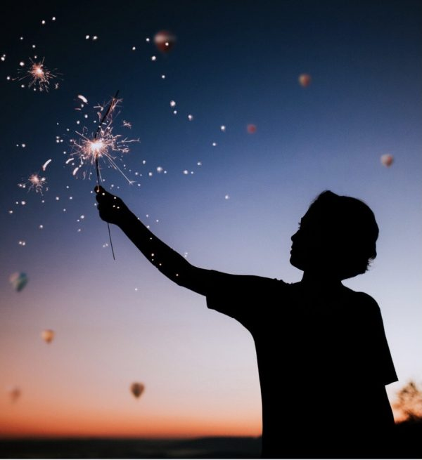 An image of a person with a sparkler representing inner spark