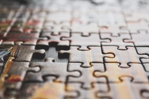A jigsaw puzzle with a missing piece, representing loss of focus